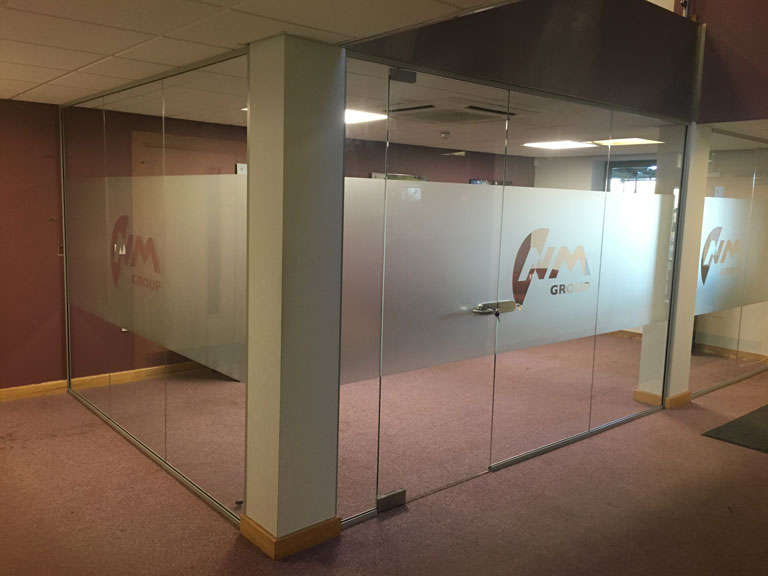 Frameless Glazed Partitions for NM Group